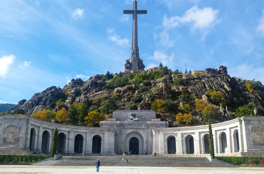 Entrance of the Valley of the Fallen, granite arches and big cross on top of the crypt